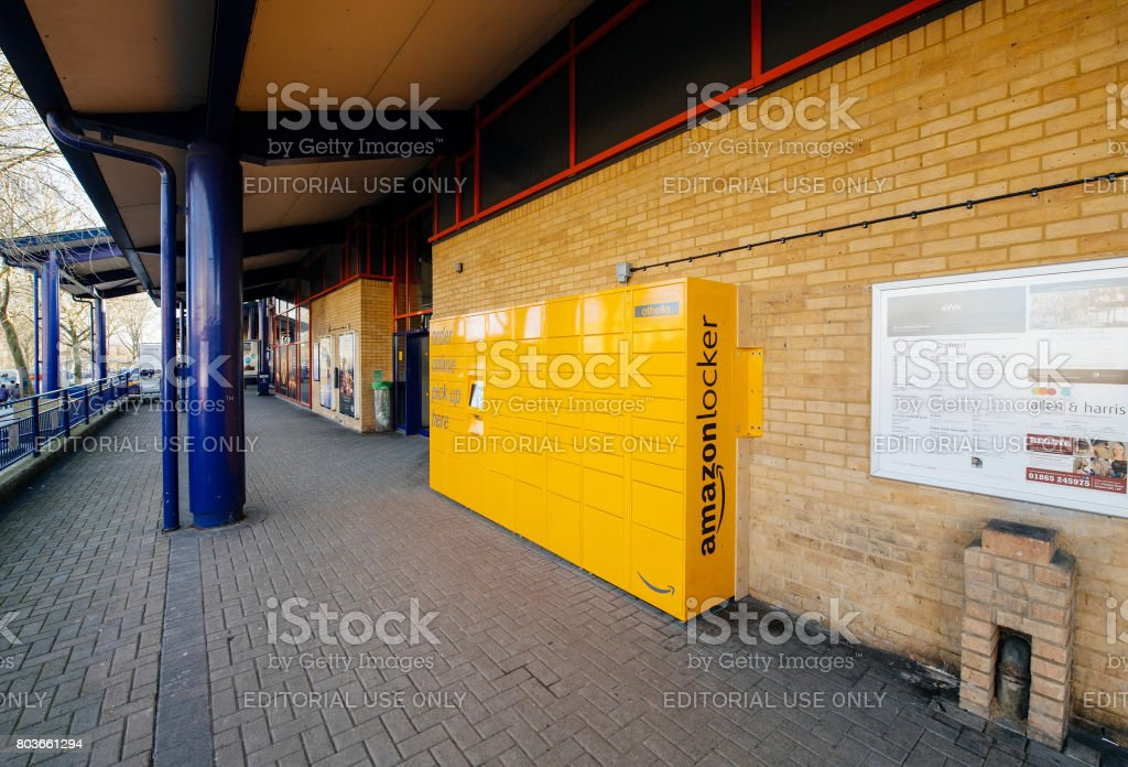 Amazon Locker yellow parcel delivery machine at train statiaon in UK stock photo