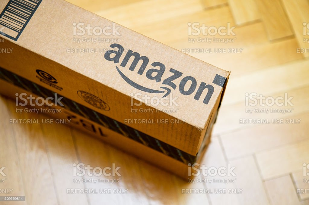 Amazon logotype printed on cardboard box stock photo