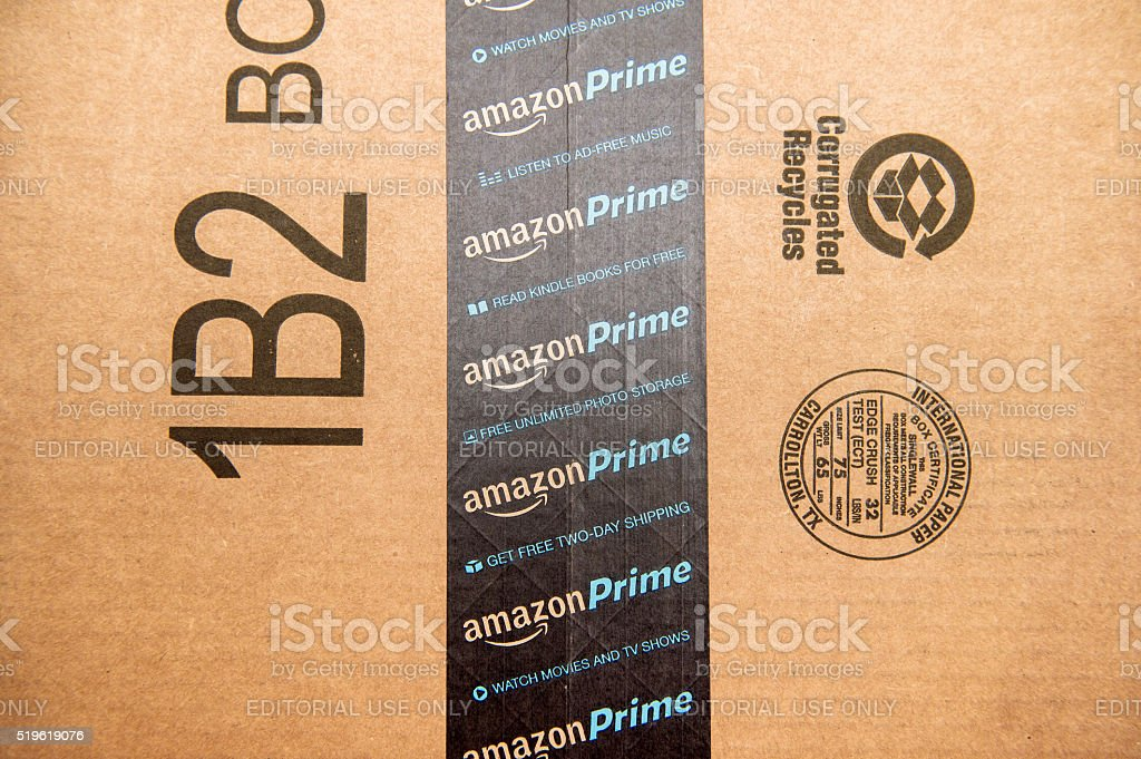Amazon Prime logotype printed on cardboard box security scotch stock photo