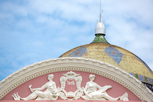 Amazon Theatre with blue sky, opera house in Manaus, Brazil Roof Details from the Amazon Theatre (Portuguese: Teatro Amazonas) with blue cloudy sky, opera house located in Manaus, Amazonas Brazil manaus stock pictures, royalty-free photos & images