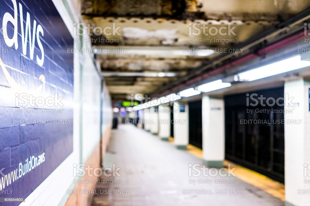 Amazon Web Services AWS advertisement ad sign closeup in underground transit platform in NYC Subway Station, wall tiled, arrow, side stock photo