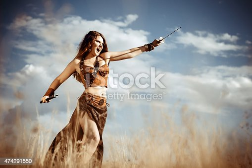istock Amazon with a sword attacks 474291550