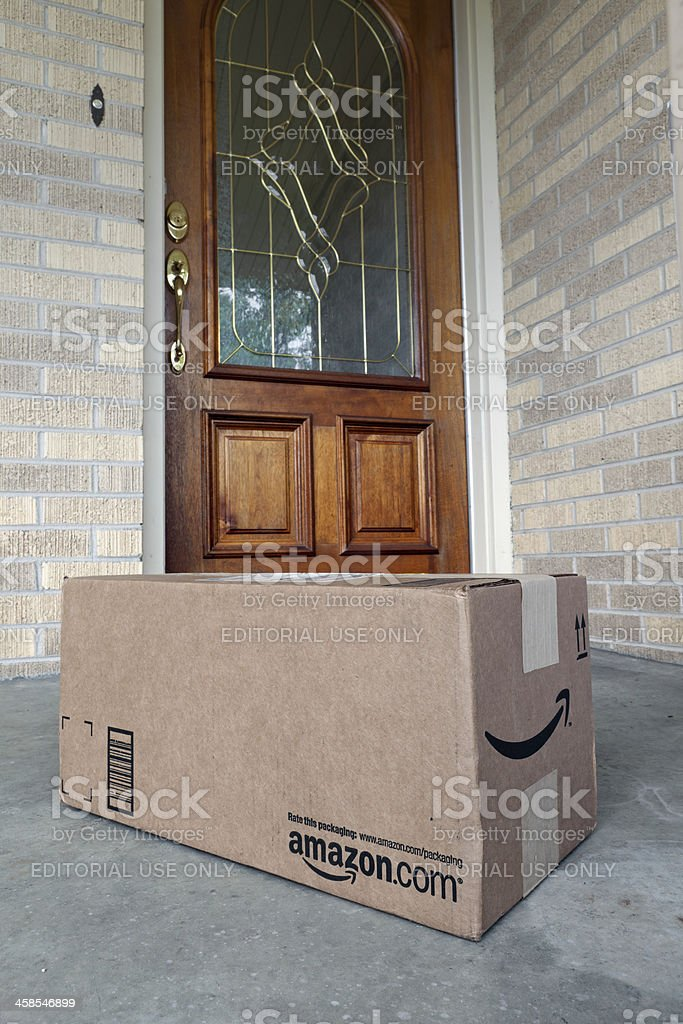 Amazon.com Package at Front Door of House stock photo