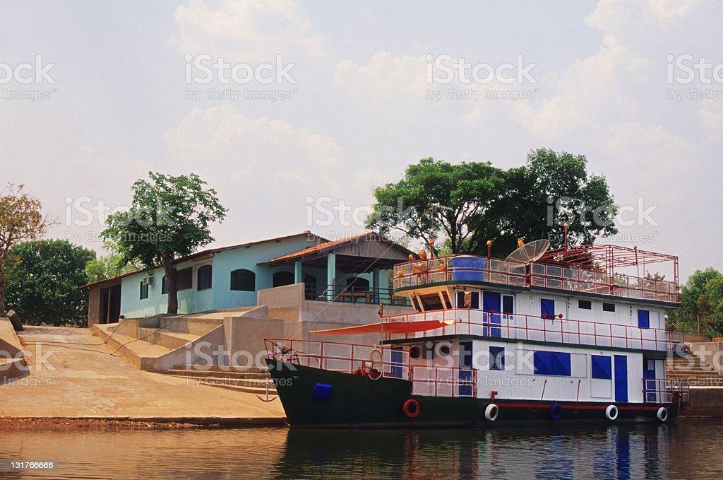 Amazonian boat moored alongside royalty-free stock photo