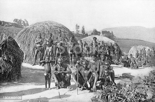 AmaZulu tribe at a Zulu kraal (village) in the Kingdom of Zululand, South Africa. Vintage photo etching circa 19th century. It was absorbed into the British Colony of Natal in 1897, and then the Union of South Africa in 1910.