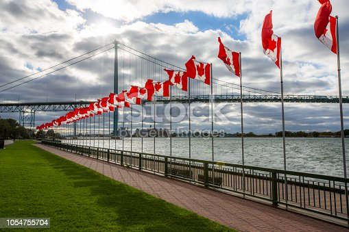 The Ambassador bridge links Detroit, Michigan with Windsor, Ontario.  It is one of the busiest trade routes in North America.  The body of water that the bridge traverses is the Detroit River.