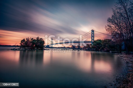 The Ambassador bridge links Detroit, Michigan with Windsor, Ontario.  It is one of the busiest trade routes in North America.  This photo was taken from Windsor, Ontario, Canada, facing North towards Detroit.  The body of water that the bridge traverses is the Detroit River.