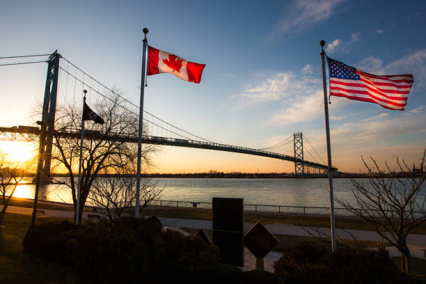 ambassador bridge with flags - canada stock photos and pictures