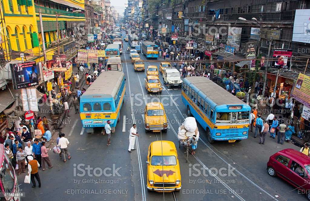 Ambassador taxi cabs drive down the busy street stock photo