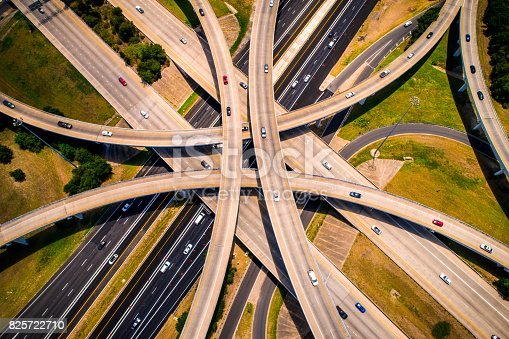 istock Amber Abstract Aerial Straight down view Curved highways and Interchanges and Overpasses aerial drone high above 825722710