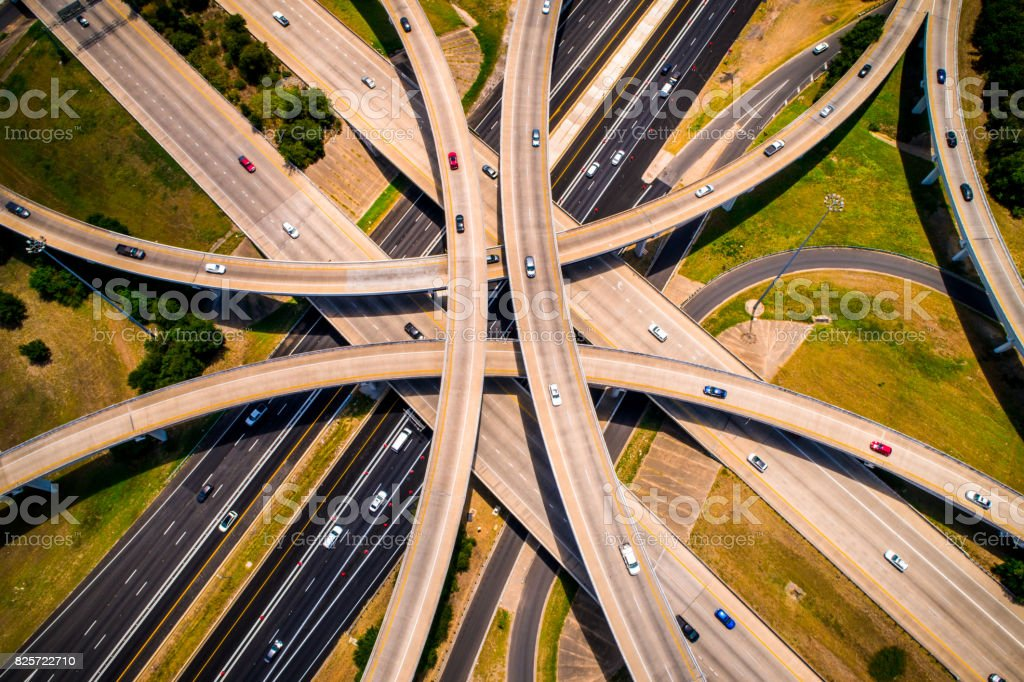 Amber Abstract Aerial Straight down view Curved highways and Interchanges and Overpasses aerial drone high above stock photo