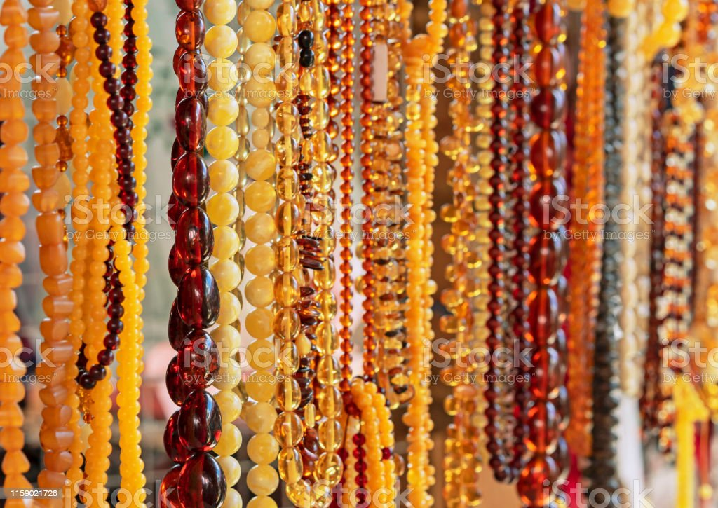 Amber background of beads. Amber beads in a jewelry shop window....