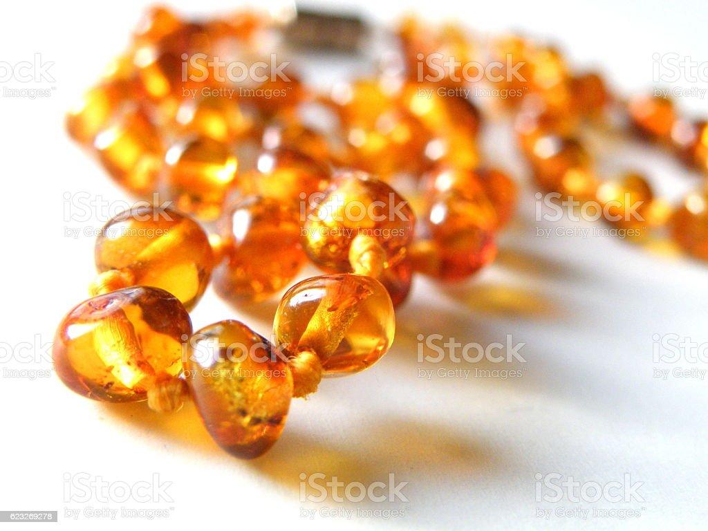 Amber bead stock photo