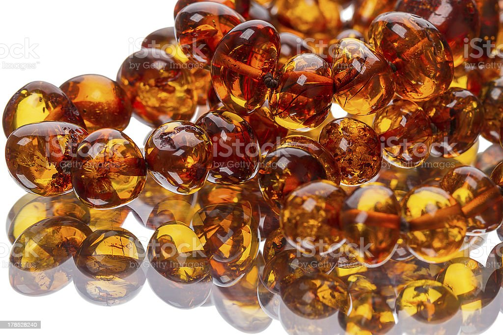 Amber beads on the mirror stock photo