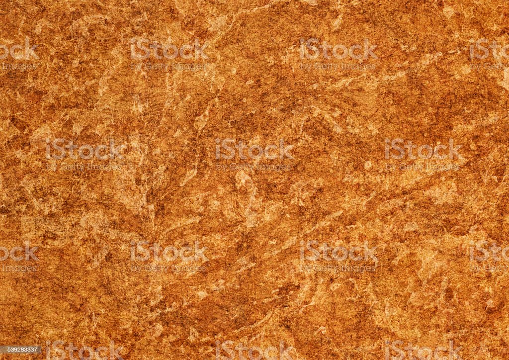 Amber Brown Recycled Kraft Paper Mottled Grunge Texture stock photo
