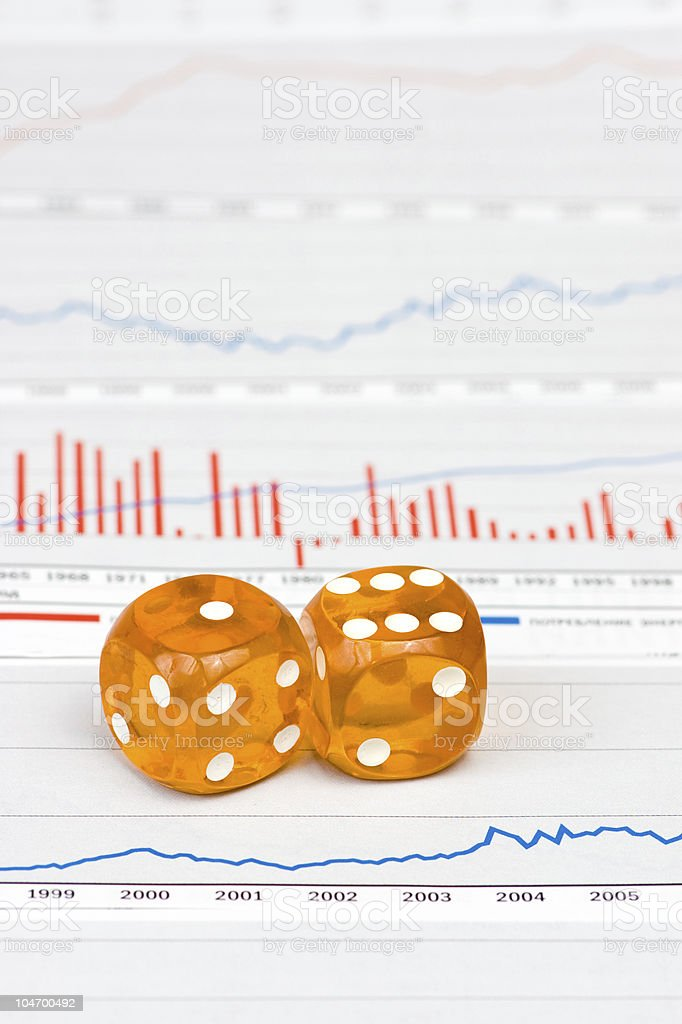 Amber dice on figures royalty-free stock photo