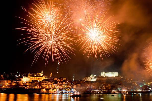 Amber fireworks over the harbour on St. John's night stock photo