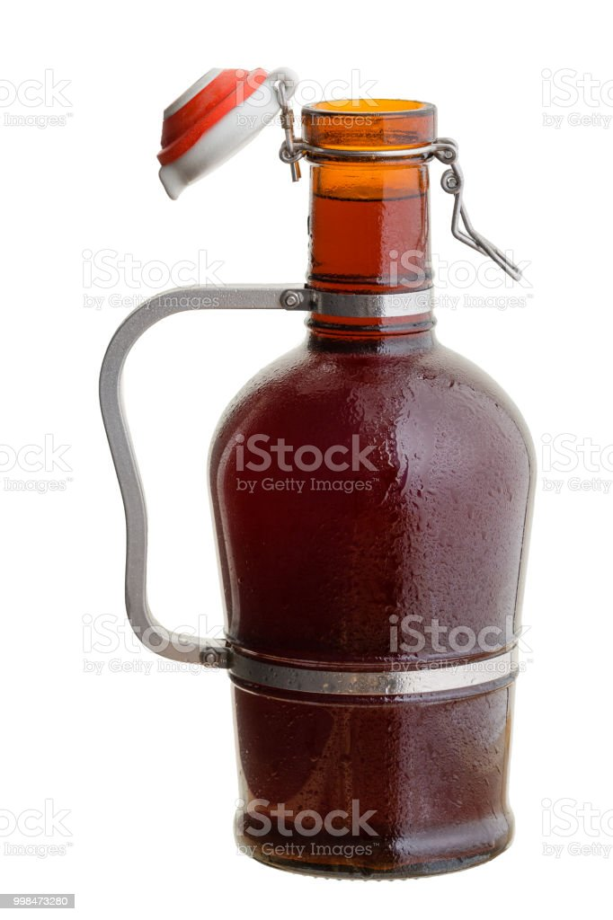 Amber glass German growler jug filled with beer stock photo