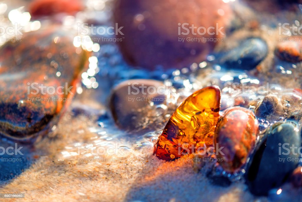 Amber on a beach of the Baltic Sea stock photo