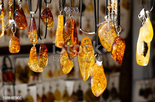 Amber necklace. Amber of different colors and sizes. Exposition of stones of amber for tourists, souvenir