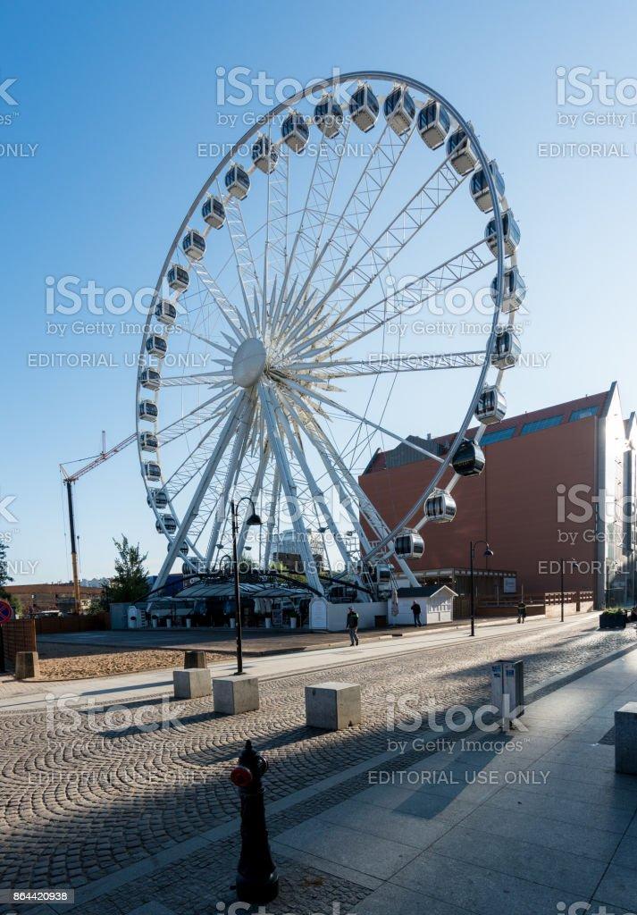 Amber Sky ferris wheel near old town Gdansk stock photo