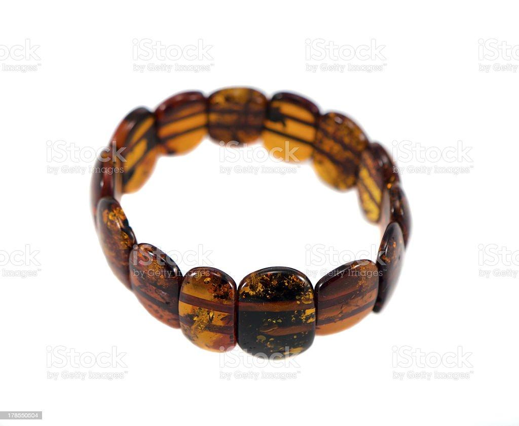 Amber stone bracelet isolated on white royalty-free stock photo