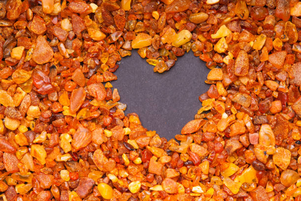 Amber stones and heart shape - foto stock