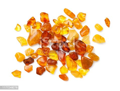 Ambers isolated on white background. Pieces of polished amber. Top view, flat lay
