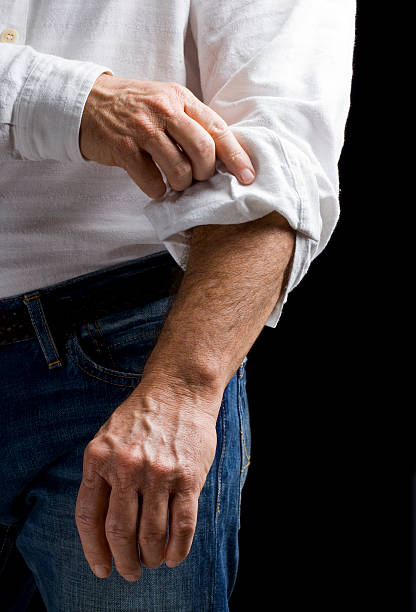 Ambition: Rolling up sleeve stock photo