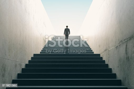 istock Ambitions concept with businessman climbing stairs 511601860