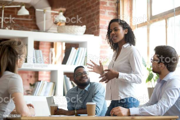 Ambitious african black female employee speaking at diverse meeting picture id1090216744?b=1&k=6&m=1090216744&s=612x612&h=iqmw6znyzlflniwta8vpvo6uzria57wr7pqmighuyhg=