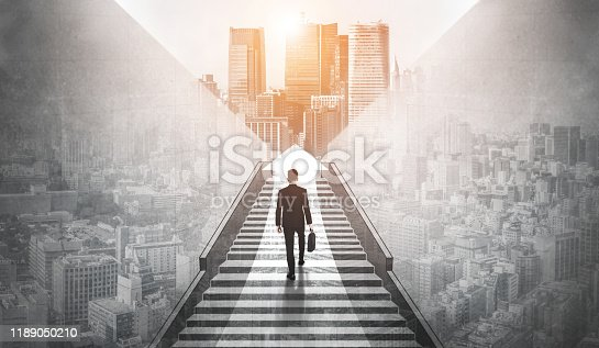 Ambitious business man climbing stairs to meet incoming challenge and business opportunity. The high stair represents the concept of career path success, future planning and business competitions.