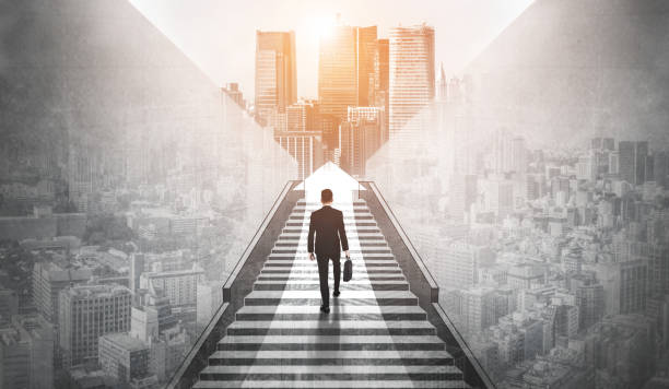 Ambitious business man climbing stairs to success. Ambitious business man climbing stairs to meet incoming challenge and business opportunity. The high stair represents the concept of career path success, future planning and business competitions. opportunity stock pictures, royalty-free photos & images