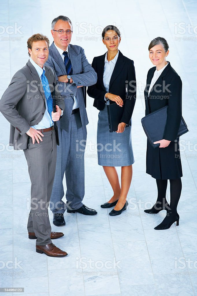 Ambitious business team smiling royalty-free stock photo