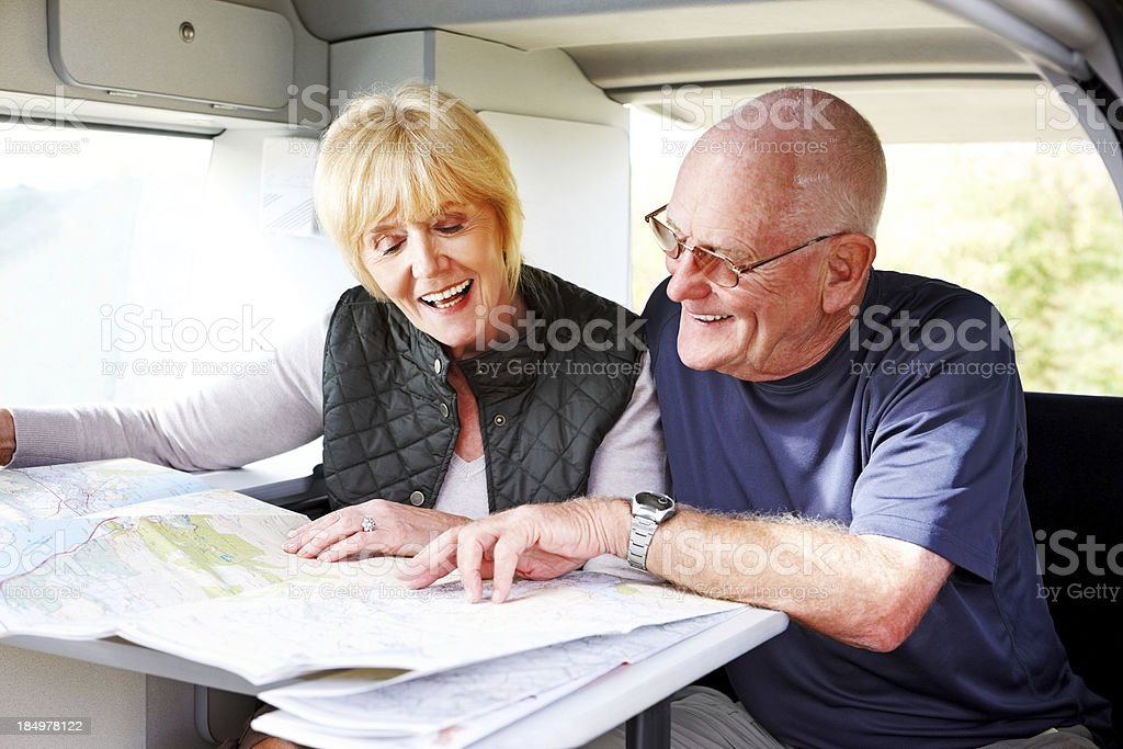 Ambitious old couple planning their travels together royalty-free stock photo