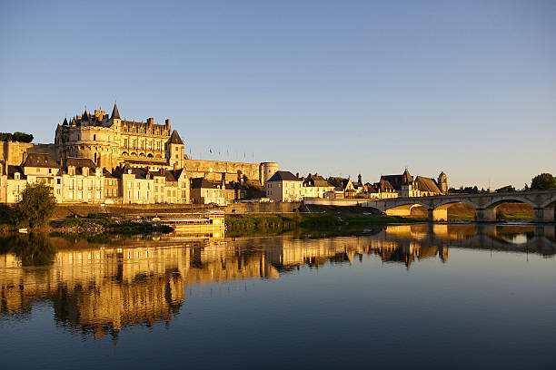 Amboise castle reflected in the water at dusk stock photo
