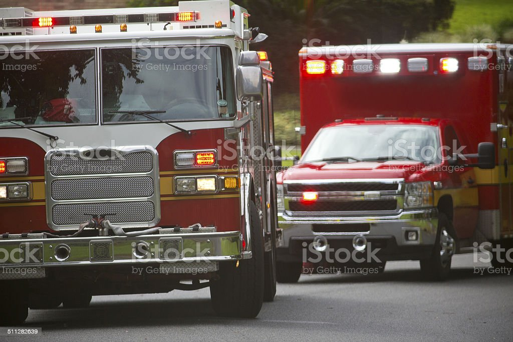 Ambulance and Firetruck in a residential neighborhood