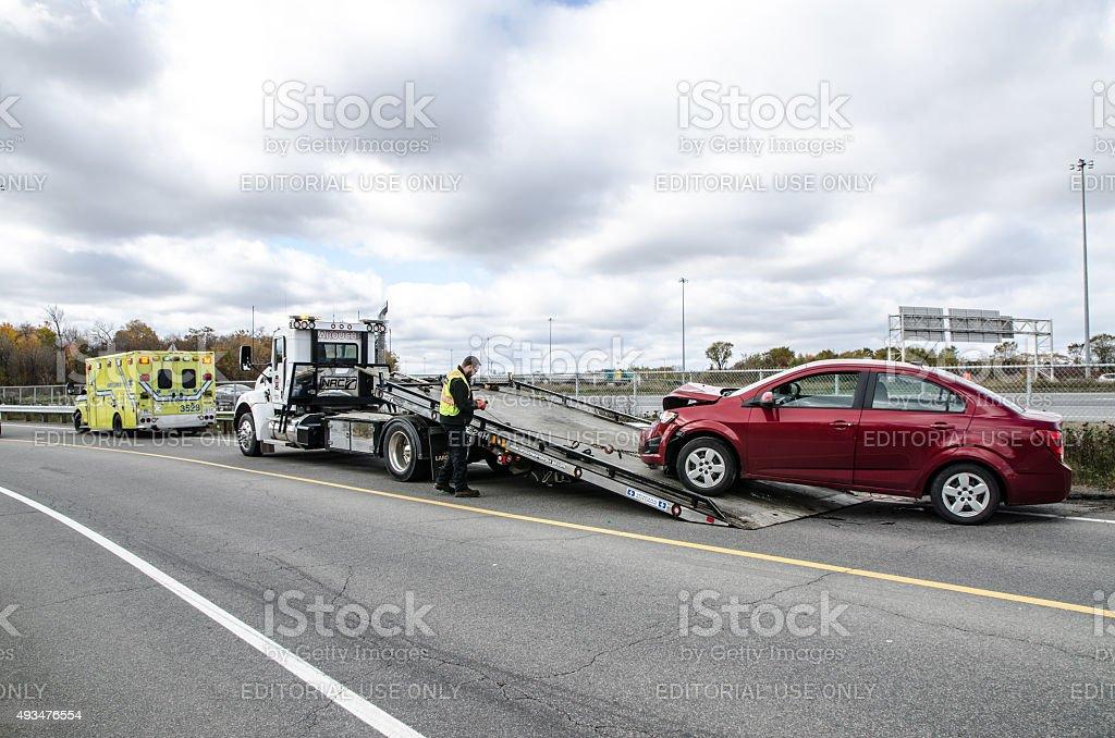Ambulance and towing stock photo