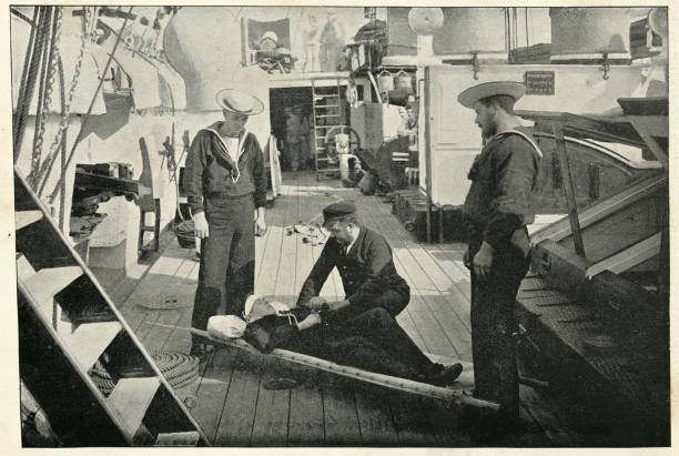 Ambulance drill on board HMS Tartar, Royal navy crusier Vintage photograph of Ambulance drill on board HMS Tartar, Royal navy crusier, 19th Century sailor suit stock pictures, royalty-free photos & images