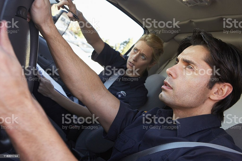 Ambulance driver on the way to an emergency stock photo