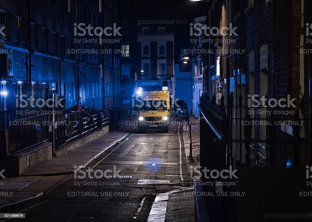 Ambulance driving at night in Paddington, London stock photo