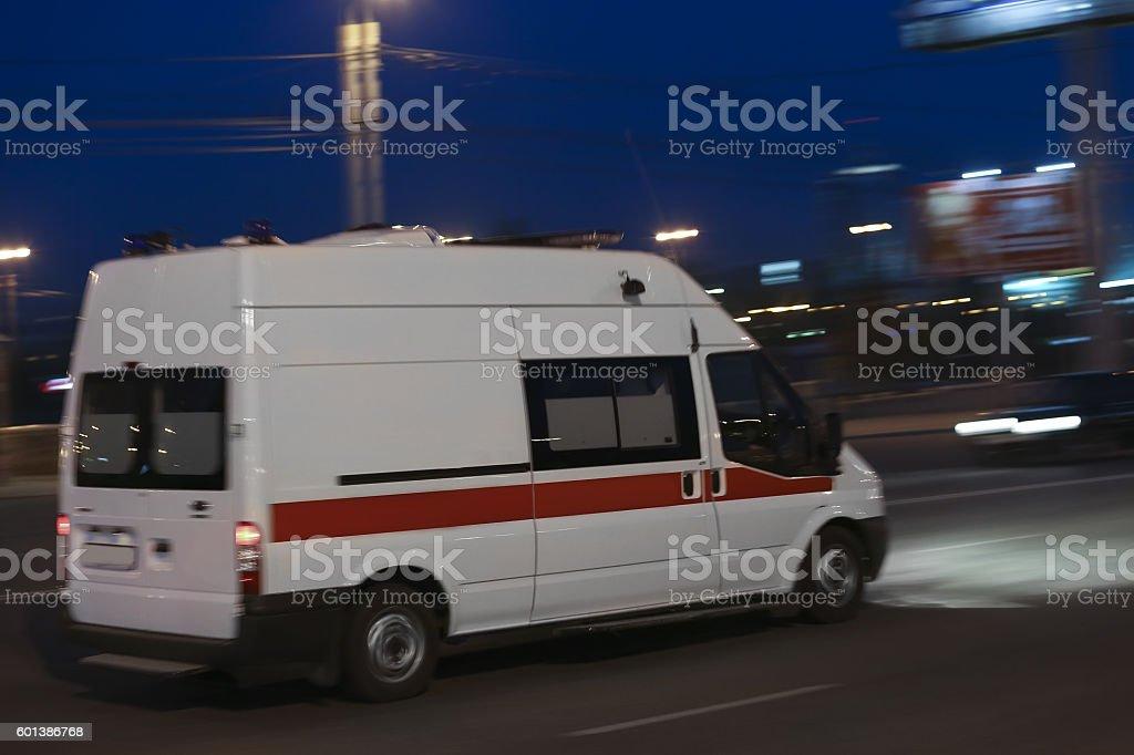 ambulance goes on night city stock photo