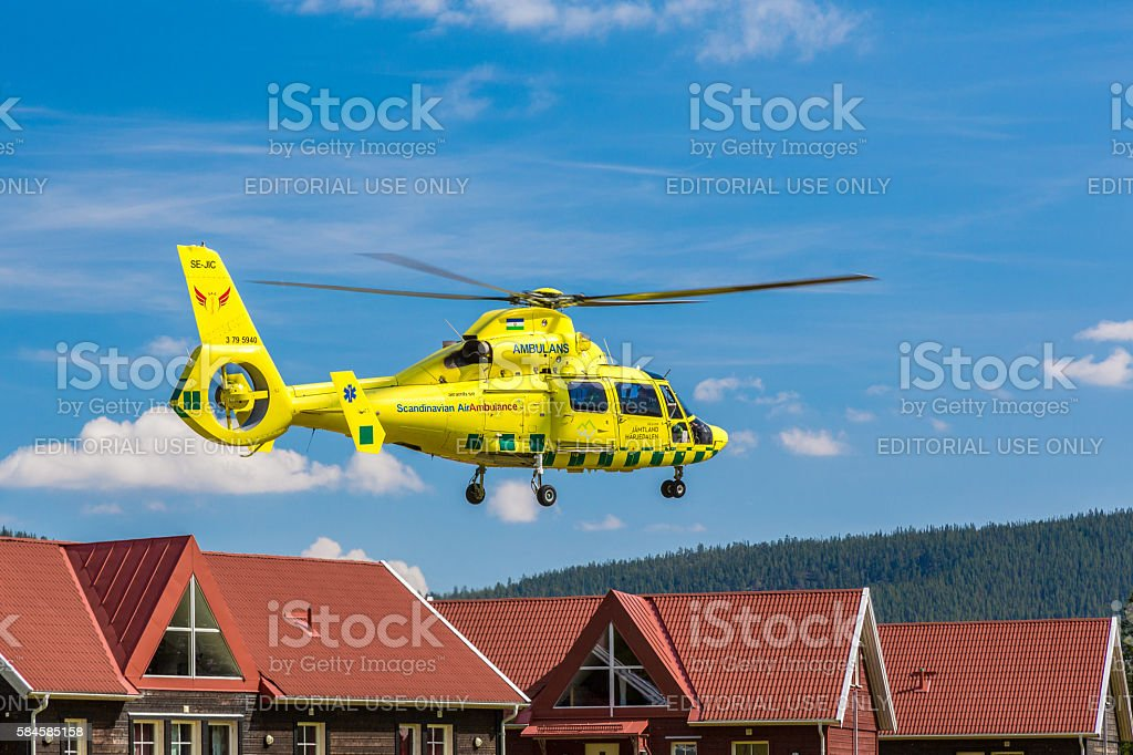 Ambulance helicopter close to houses. stock photo
