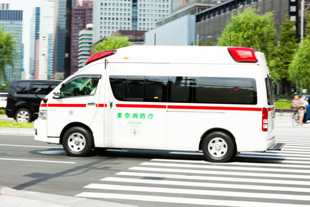 Ambulance in downtown Tokyo, Japan stock photo