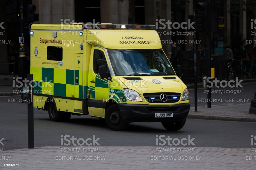 Ambulance in motion on the street in London stock photo