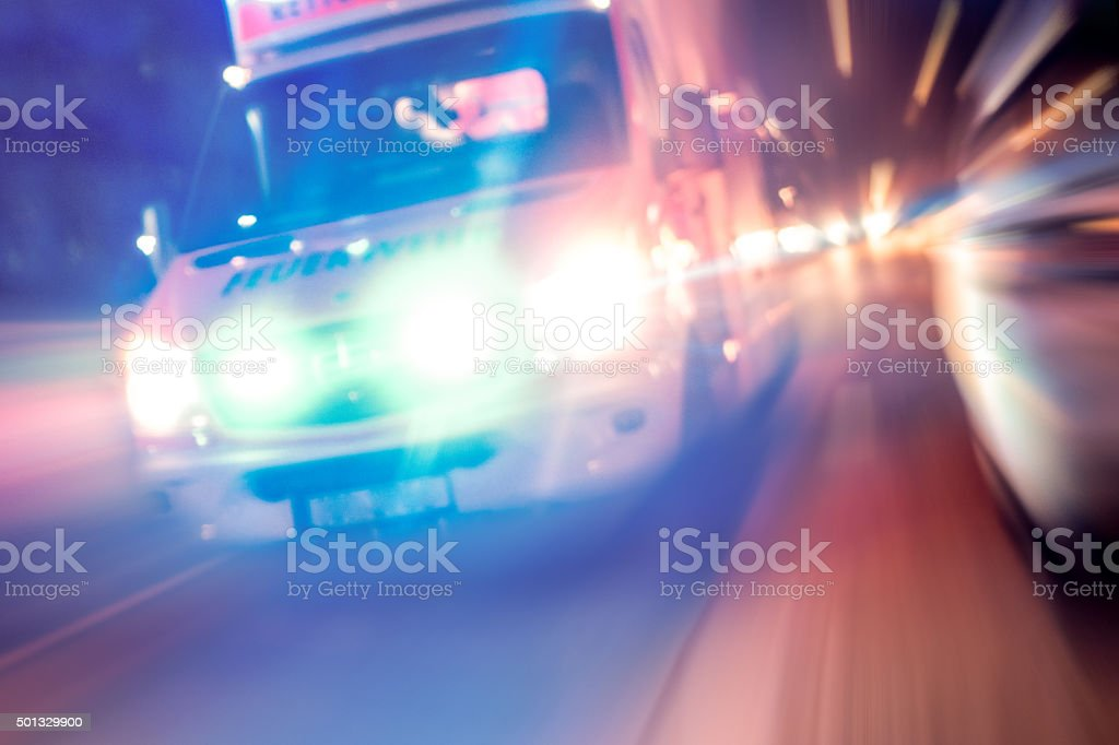 Ambulance in traffic at night stock photo