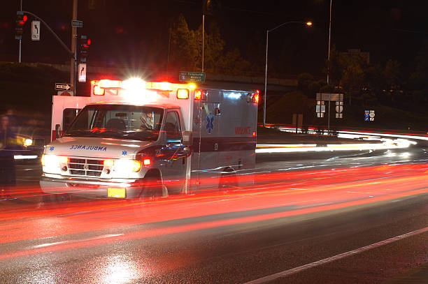 ambulance in traffic - ambulance stock photos and pictures