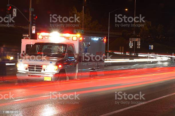 Ambulance In Traffic Stock Photo - Download Image Now