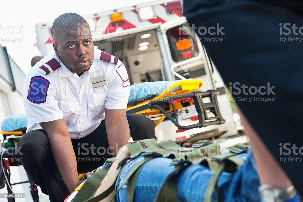 Ambulance medics moving victim on stretcher royalty-free stock photo