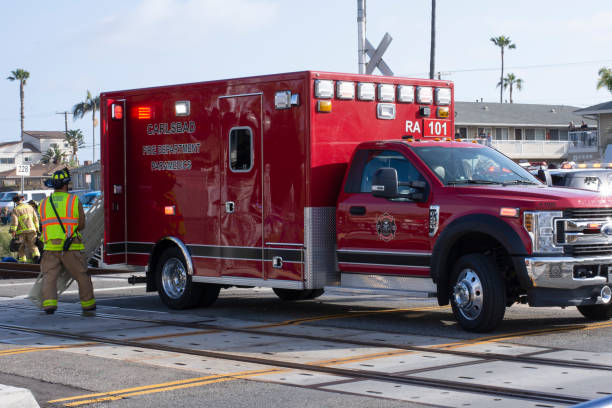 Ambulance on the scene of an accident involving an SUV and a train in Oceanside stock photo
